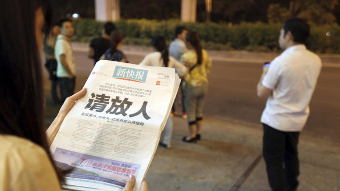 Chinese newspaper urges police to release reporter