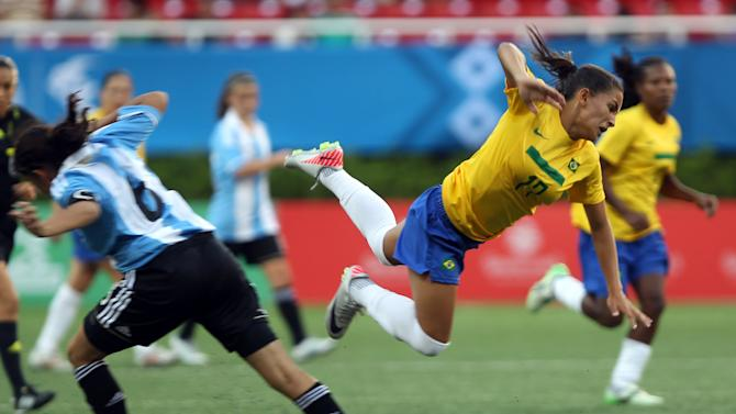 Brazil's Debora de Oliveira, right, flies after being tackled by Argentina's Maria Quinones during a women's soccer match at the Pan American Games in Guadalajara, Mexico, Tuesday Oct. 18, 2011. (AP Photo/Juan Karita)