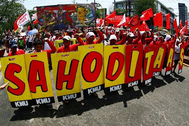 Militant workers group converge at Liwasan Bonifacio in Manila, Philippines 01 May 2011 to sends their highest salute to the working people of the world and in the country in commemorating the 125th celebration of Labor day. (Jerome Ascano/NPPA Images)