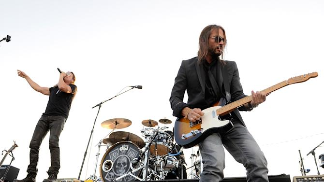 Musicians Fher Olvera, left, and Sergio Vallin of Mana perform during a campaign event for President Barack Obama at Desert Pines High School on Sunday, Sept. 30, 2012 in Las Vegas. Obama is spending three days in Henderson, Nevada to prepare for the first presidential debate on Oct. 3 in Denver against GOP challenger Mitt Romney. (AP Photo/David Becker)