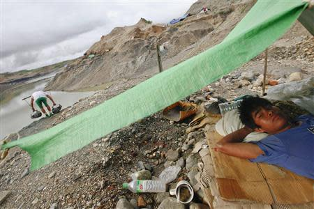 A hand-picker rests in his tent at a jade mine in Hpakant township, Kachin State