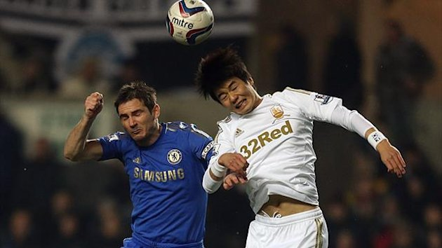 Swansea City's Sung-Yeung Ki (right) and Chelsea's Frank Lampard battle for the ball (PA)