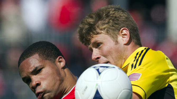 FILE - In this March 31, 2012 file photo, Columbus Crew midfielder Kirk Urso, right, battles for the ball with Toronto FC forward Ryan Johnson during first half MLS soccer action in Toronto. Urso has died at an Ohio hospital. Franklin County Coroner Dr. Jan Gorniak says Urso was pronounced dead at 1:50 a.m., Sunday, Aug. 5, 2012, at Grant Medical Center in Columbus, Ohio. The coroner says no cause of death has been determined and an autopsy will be performed Monday. (AP Photo/The Canadian Press, Frank Gunn, File)