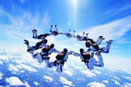 Cloud Computing in Businesses: Adoption, Impact and Outlook image skydivers 300x199