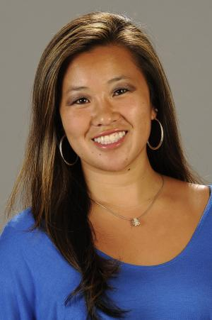 FILE - This photo provided Feb. 4, 2013 by Cal State Fullerton shows Cal State Fullerton assistant women's NCCA college basketball coach Monica Quan in Fullerton, Calif. Quan and her fiance Keith Lawrence were found shot to death on the top floor of a parking structure at the complex, police said. Four days before her death, Monica Quan had news for her team. Quan, an assistant coach at Cal State Fullerton, held up her hand to show off an engagement ring from Lawrence. Authorities believe Quan and Lawrence were shot to death by ex-Los Angeles policeman Christopher Dorner, who'd written a manifesto expressing anger over his firing by the LAPD. (AP Photo/Cal State Fullerton, file)