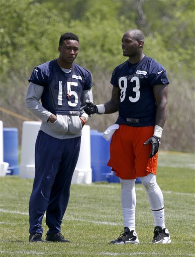 Chicago Bears wide receiver Brandon Marshall (15), rehabbing from off-season hip surgery, talks with tight end Martellus Bennett during the Bears' NFL football practice in Lake Forest, Ill., Tuesday,