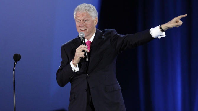 "Former president Bill Clinton speaks at the ""A Decade of Difference"" concert at the Hollywood Bowl in Los Angeles, Saturday, Oct. 15, 2011. The concert is part of ""Decade of Difference"" weekend, which celebrates 10 years of the William J. Clinton Foundation. (AP Photo/Matt Sayles)"