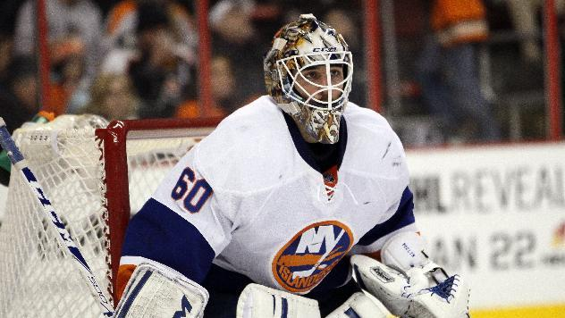 New York Islanders' Kevin Poulin in an NHL hockey game with the Philadelphia Flyers, Saturday, Jan. 18,  2014, in Philadelphia
