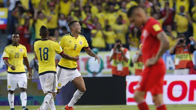 Colombia's Cardona celebrates with his teammate Fabra, as teammate Castillo looks on, after scoring during their 2018 World Cup qualifying soccer match against Peru at in Barranquilla, Colombia