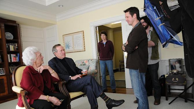 "This image released by HBO shows former first lady Barbara Bush, from left, former President George H. W. Bush, Kris Conde, Stephen Glidden, Jeffrey Roth during the filming of ""41,"" a documentary about Bush premiering Thursday, June 14, at 9:00 p.m. EST on HBO. (AP Photo/HBO, Brian Blake)"