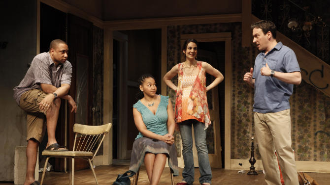 """FILE - In this theater publicity file photo released by The Publicity Office, from left, Damon Gupton, Crystal A. Dickinson, Annie Parisse and Jeremy Shamos are shown in a scene from Bruce Norris' """"Clybourne Park,"""" at Playwrights Horizons in New York. The Pulitzer Prize-winning playwright of """"Clybourne Park,"""" says he withdrew permission for a Berlin theater company to produce the play after learning that one of the actors would perform the roles in blackface. (AP Photo/The Publicity Office, Joan Marcus, File)"""