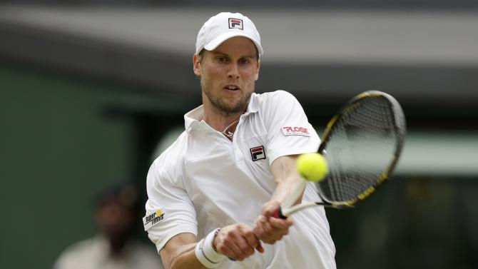 Andreas Seppi of Italy hits a shot during his match against Andy Murray of Britain at the Wimbledon Tennis Championships in London