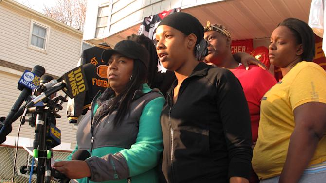 Yamiesse Lawrence, left, and Quaresha Boston, standing next to Lawrence, a cousin and niece, respectively, of Kansas City Chiefs linebacker Jovan Belcher, read a statement to the media, Monday, Dec. 3, 2012, in West Babylon, N.Y. Kansas City, Mo., police said Belcher shot and killed his girlfriend and then committed suicide on Saturday, Dec. 1. Standing behind Lawrence and Boston are Belcher's sisters, Charmaine Shepherd, second from right, and Jeanine Shepherd, right. (AP Photo/Frank Eltman)