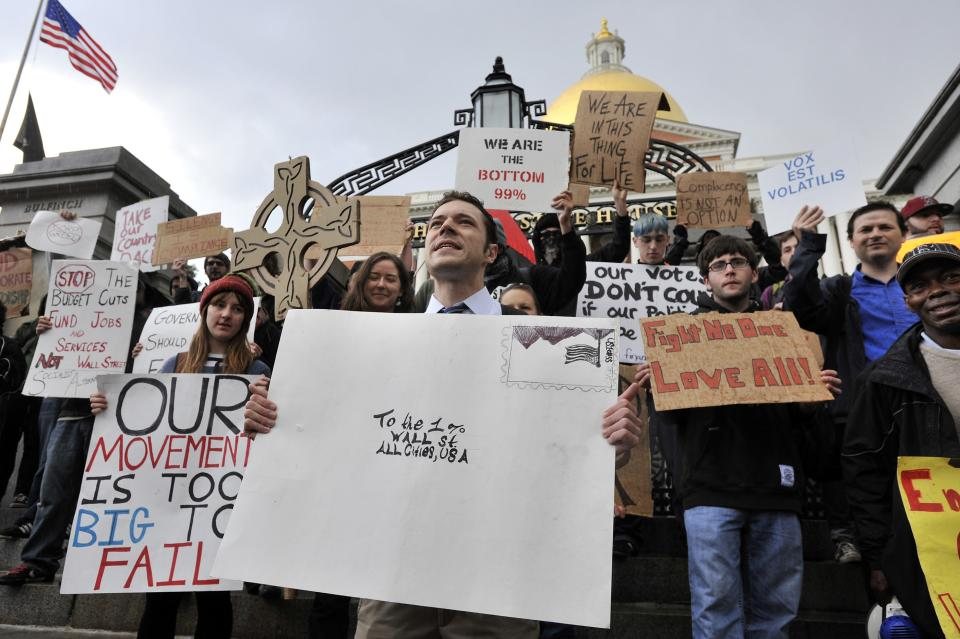 Jason Potteiger, center, leads demonstrators in a chant in front of the Statehouse, in Boston, as part of an Occupy Boston demonstration on Monday, Oct. 3, 2011. The group is part of a nationwide grassroots movement in support of the ongoing Wall Street protests in New York. (AP Photo/Josh Reynolds)