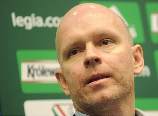 Henning Berg from Norway attends a press conference during which he was presented as the new coach of Poland's top soccer team Legia Warszawa, in Warsaw, Poland, Friday, Dec. 20, 2013