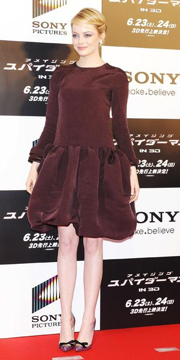 Wow, Emma really hit a fashion misstep here while in Tokyo, Japan. The actress' Rochas dress looks all wrong on her: from the drab colour to the unflattering full skirt and the top that makes her look