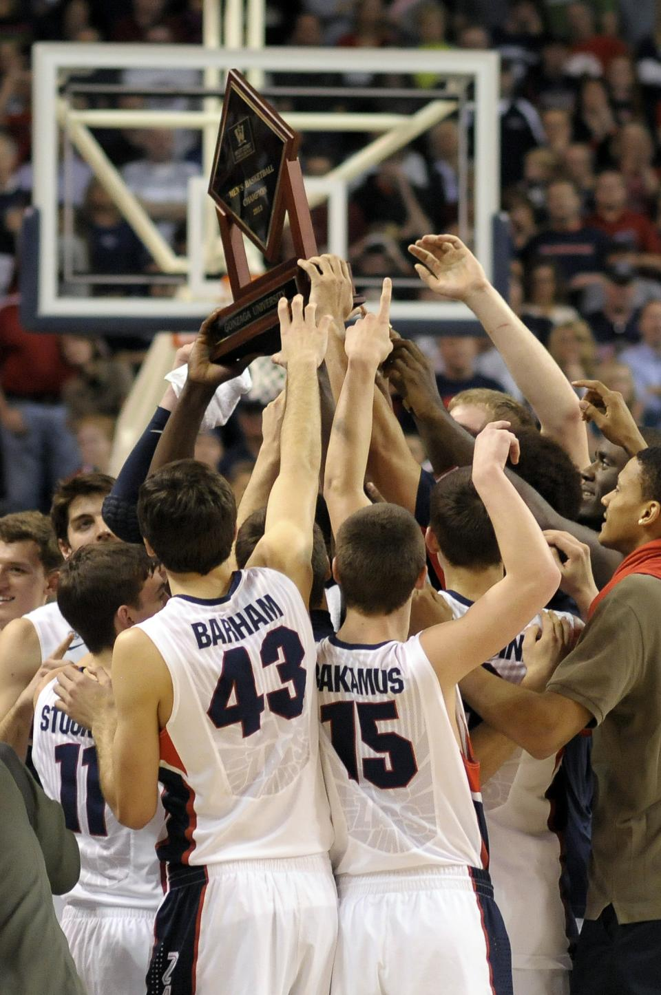 Gonzaga celebrates their West Coast Conference Championship after an NCAA college basketball game against Portland, Saturday, March 2, 2013, in Spokane, Wash. Gonzaga won 81-52. (AP Photo/Jed Conklin)