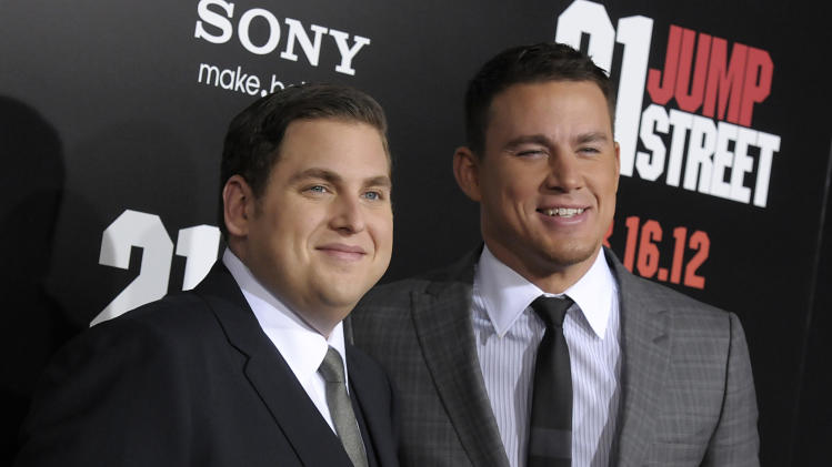 "Actor Jonah Hill, left, and actor Channing Tatum arrive at the premiere of the feature film ""21 Jump Street"" in Los Angeles on Tuesday, March 13, 2012. (AP Photo/Dan Steinberg)"