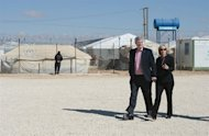 Prime Minister Stephen Harper and wife Laureen Harper visit Za'atri Refugee Camp in Jordan on Friday, January 24, 2014. While in the Middle East Harper is visiting Israel, the West Bank, and Jordan. THE CANADIAN PRESS/Sean Kilpatrick