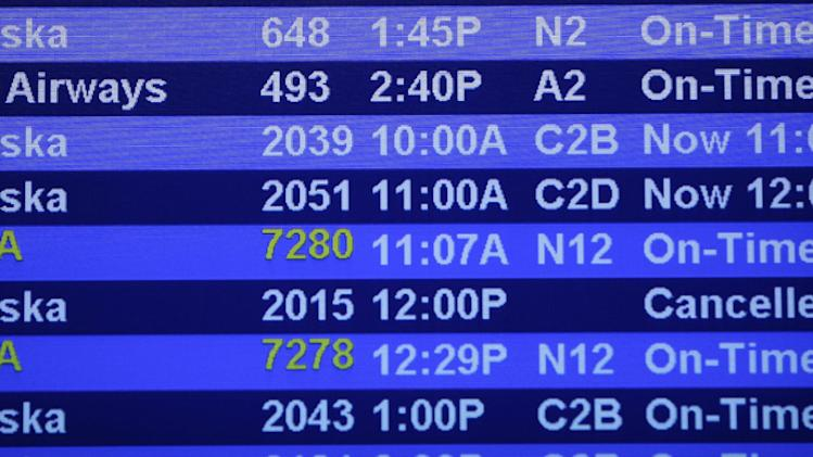 Flight departure times for Alaska Airlines flights are shown Monday, Oct. 8, 2012, at Seattle-Tacoma International Airport in Seattle, during a system-wide outage of the computers the airline uses to check in passengers. Some flights were able to be checked in manually, but most flights were delayed or canceled. (AP Photo/Ted S. Warren)