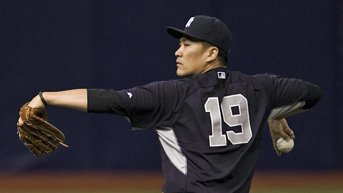 New York Yankees pitcher Masahiro Tanaka loosens up before throwing in the bullpen before a baseball game between the Yankees and the Tampa Bay Rays Saturday, Aug. 16, 2014, in St. Petersburg, Fla. (AP Photo/Steve Nesius)