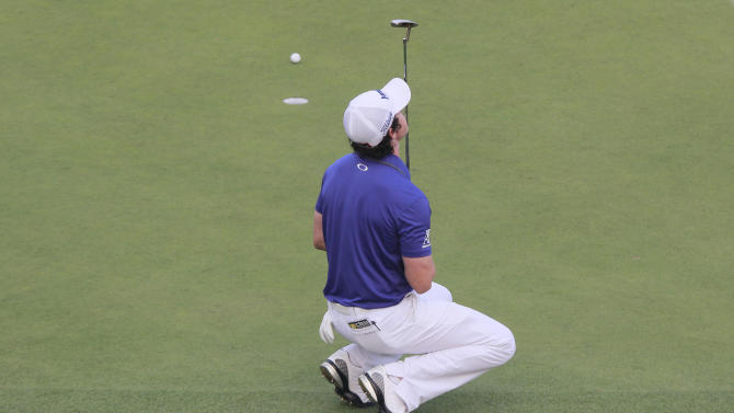 Rory McIlroy of Northern Ireland reacts as he missed a birdie putt on the 18th green during the final round of the Masters golf tournament in Shanghai, China on Sunday Oct. 28, 2012. (AP Photo)