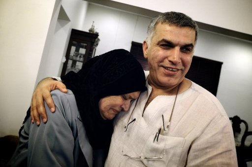 Bahraini Shiite human rights activist Nabil Rajab hugs his mother at his home in the village of Bani Jamrah, after he was released from jail. Bahrain released him from jail after the government announced $2.6 million compensation for 17 people killed in last year's bloody crackdown