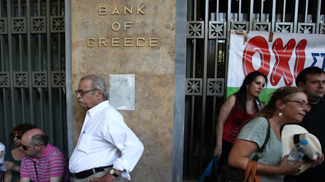 Protesters gather outside Bank of Greece with the banner reads ''No'' in Athens, Monday, June 30, 2012.  The state-run bank was privatized last week, in a no-cash transfer to the private Piraeus Bank. Bank workers on Monday held a 24-hour strike to protest cuts under Greece austerity program. (AP Photo/Thanassis Stavrakis)