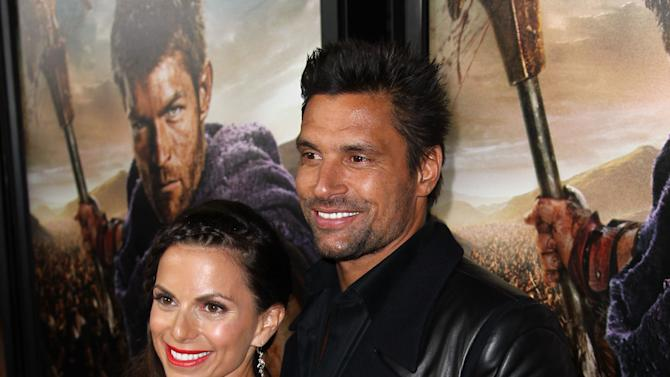 """Manu Bennett, right, and Karin Horen arrive at the premiere of """"Spartacus: War of the Damned"""" on Tuesday, Jan. 22, 2013 in Los Angeles. """"Spartacus: War of the Damned"""" premieres Friday, Jan. 25 at 9PM on STARZ. (Photo by Matt Sayles/Invision for STARZ/AP Images)"""