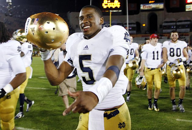 Notre Dame quarterback Everett Golson celebrates after Notre Dame defeated Southern California 22-13 in an NCAA college football game, Saturday, Nov. 24, 2012, in Los Angeles. (AP Photo/Danny Moloshok)