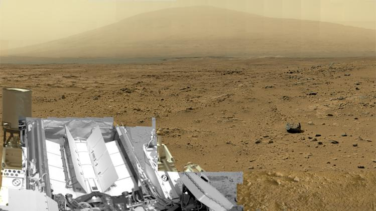 This photo released by NASA shows a photo stitched together from nearly 900 images taken by the NASA rover Curiosity showing a section of Gale Crater near the Martian equator. Nearly a year after landing, Curiosity is finally starting the drive to a mountain in search of the chemical building blocks of life. (AP Photo/NASA)