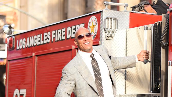 """Dwayne Johnson arrives at the world premiere of """"San Andreas"""" at the TCL Chinese Theatre on Tuesday, May 26, 2015, in Los Angeles. (Photo by Richard Shotwell/Invision/AP)"""