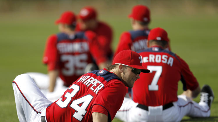 Washington Nationals' Bryce Harper stretches during the team's first official full squad workout at spring training baseball, Saturday, Feb. 25, 2012, in Viera, Fla. (AP Photo/Julio Cortez)