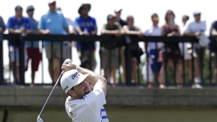 Keegan Bradley hits off the 10th tee as fans watch from a bridge during the second round of the Byron Nelson Championship golf tournament, Friday, May 17, 2013, in Irving, Texas. Bradley ended the day at  11 under par for the tournament. (AP Photo/Tony Gutierrez)
