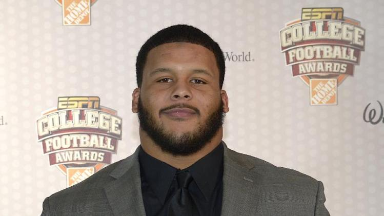 Pittsburgh defensive tackle Aaron Donald poses with the Outland Trophy after winning the honor during the College Football Awards show in Lake Buena Vista, Fla., Thursday, Dec. 12, 2013.(AP Photo/Phelan M. Ebenhack)