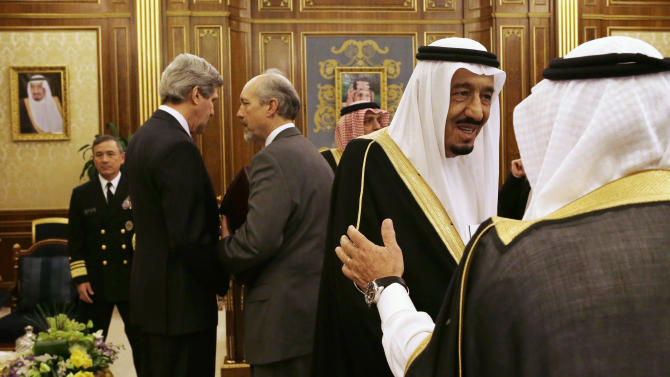 In this March 4, 2013, photo, Saudi Deputy Foreign Minister Prince Abdulaziz bin Abdullah, second from right, is greeted as U.S. Secretary of State John Kerry, second from left, speaks with an adviser before the start of their meeting at Yamamah Palace in Riyadh, Saudi Arabia. With the smile of a seasoned politician, a flair for languages and a vast repertoire of personal anecdotes, Kerry schmoozed and cajoled his way through Europe and the Middle East on his first trip abroad as America's top envoy over the past 10 days. (AP Photo/Jacquelyn Martin, Pool)