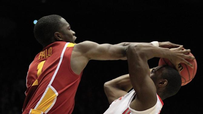 Iowa State guard Bubu Palo (1) blocks a shot by Ohio State guard Shannon Scott in the first half of a third-round game of the NCAA college basketball tournament Sunday  March 24, 2013, in Dayton, Ohio. (AP Photo/Skip Peterson)