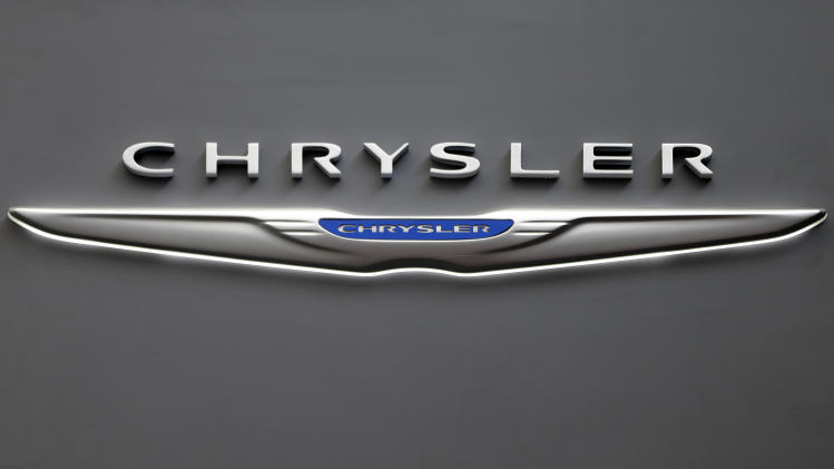 This Feb. 14, 2013 photo shows the Chrysler logo on a sign at the 2013 Pittsburgh Auto Show in Pittsburgh. Chrysler's U.S. sales rose 11 percent in May, a sign that auto sales rebounded from a slight dip in April and will continue to boost the U.S. economy. (AP Photo/Gene J. Puskar)