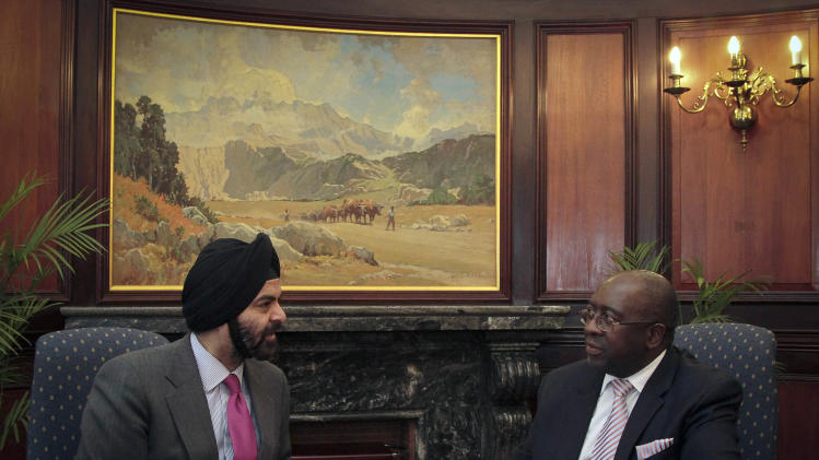 IMAGE DISTRIBUTED FOR MASTERCARD WORLDWIDE - South Africa's Deputy Minister of Finance Nhlanhla Nene (right) met with Ajay Banga, MasterCard Worldwide President and CEO (left) in Pretoria on Thursday, Jan. 17, 2013. They discussed the importance of the financial sector and Government in working together to ensure financial inclusion for all South Africans. According to the FinScope South Africa 2012 study, 67% of the South African population aged 16 and above is banked, with this figure expected to reach 70% in 2013, thanks to the country's new social grant disbursement system introduced in March 2012. This system sees grant beneficiaries being issued with South African Social Security Agency (SASSA) Debit MasterCard cards. By the first half of 2013, an estimated 10 million South Africans - nearly one-fifth of the country's population - will be brought into the formal banking sector. (Nadine Hutton/AP Images for MasterCard Worldwide)