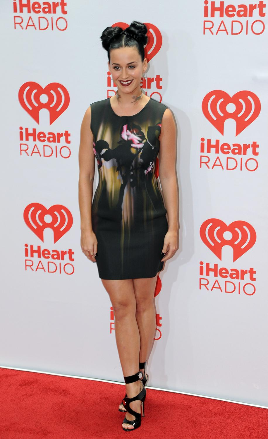 In this photo provided by the Las Vegas News Bureau, Katy Perry walks the red carpet at the MGM Grand Hotel during the iHeartRadio Music Festival in Las Vegas. Friday, Sept. 20, 2013. (AP Photo/Las Vegas News Bureau, Brian Jones)