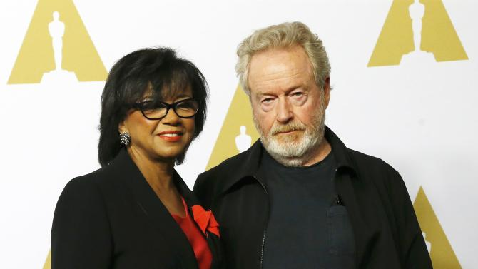 Cheryl Boone Isaacs and Ridley Scott arrive at the 88th Academy Awards nominees luncheon in Beverly Hills