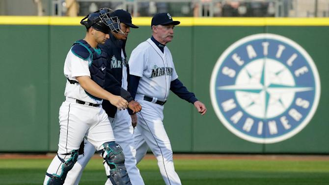 Seattle Mariners ace Felix Hernandez, center, walks with catcher Mike Zunino, left, and pitching coach Rick Waits, right, before a baseball game against the Texas Rangers, Saturday, April 18, 2015, in Seattle. (AP Photo/Ted S. Warren)