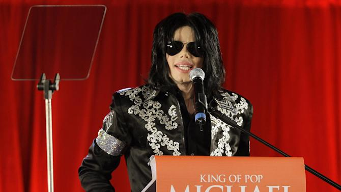 "FILE - In this March 5, 2009 file photo, US singer Michael Jackson speaks at a press conference at the London O2 Arena. Attorneys for Jackson's estate and Certain Underwriters at Lloyd's of London told a Los Angeles judge on Wednesday Jan. 15, 2014, that they had resolved a lawsuit over payment of a $17.5 million cancellation and non-appearance insurance policy. The policy was meant to cover any losses related to Jackson's ill-fated ""This Is It"" comeback shows scheduled for 2009 in London. (AP Photo/Joel Ryan, File)"