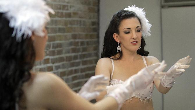 "In this March 5, 2012, photo, Nicole Nadreau, who goes by the stage name of ""Contessa"" dons part of her pinup costume for an internet pinup show at an Ybor City studio in Tampa, Fla. (AP Photo/Chris O'Meara)"