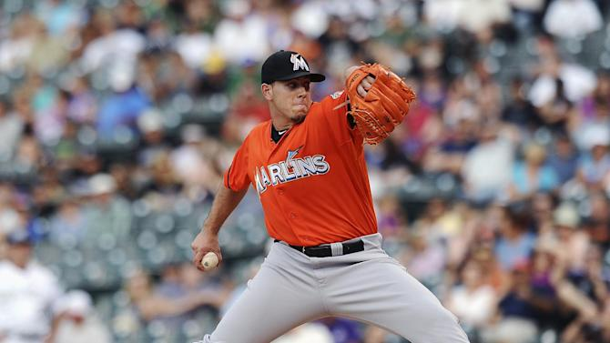 Yelich has strong debut, Marlins beat Rockies 4-2