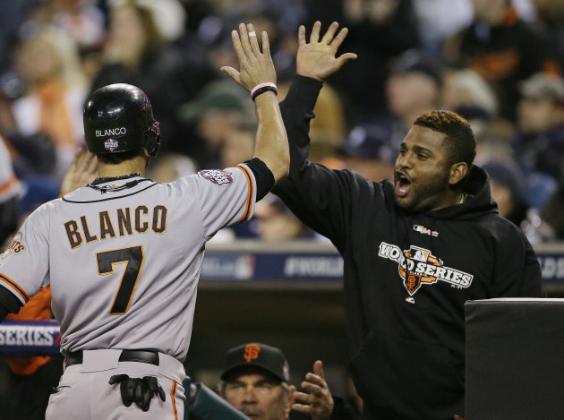 San Francisco Giants' Gregor Blanco is congratulated by Pablo Sandoval after scoring during the second inning of Game 3 of baseball's World Series against the Detroit Tigers Saturday, Oct. 27,