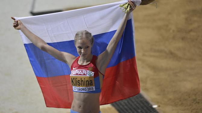 Russia's Darya Klishina pose with national flag after winning gold in the women's long jump during the Athletics Indoors European Championships in Gothenburg, Sweden, Saturday, March 2, 2013. (AP Photo/Martin Meissner)