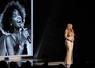 Mariah Carey speaks during the in memoriam to Whitney Houston at the BET Awards on Sunday, July 1, 2012, in Los Angeles. (Photo by Matt Sayles/Invision/AP)
