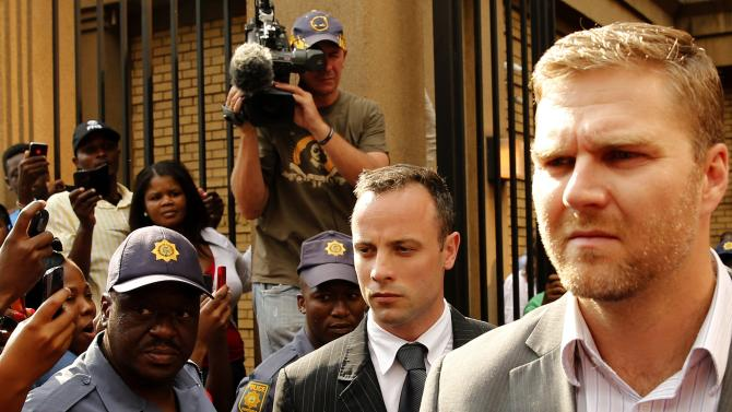 Olympic and Paralympic track star Oscar Pistorius leaves at the end of his trial for the murder of his girlfriend Reeva Steenkamp, at the North Gauteng High Court in Pretoria