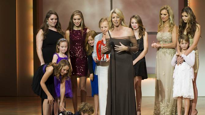 Award recipient Rory Kennedy, center, appears onstage surrounded by Kennedy family members at the Glamour Women of the Year Awards on Monday, Nov. 12, 2012 in New York. (Photo by Charles Sykes/Invision/AP)